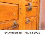 knocker in the shape of a hand... | Shutterstock . vector #757651921