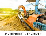 excavator parked at the site | Shutterstock . vector #757655959