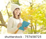 asian woman reading the book   Shutterstock . vector #757658725