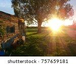 sunset farm shed scene   Shutterstock . vector #757659181