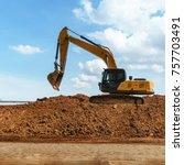 excavator with blue sky | Shutterstock . vector #757703491