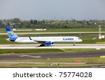 DUSSELDORF, GERMANY - APRIL 15: Boeing 757-300 landed in the airport on April, 15 2011 in Dusseldorf, Germany. Thomas Cook is one of the world leading travel groups and has 86 aircraft operated by five holiday airlines. - stock photo