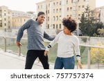 young multiethnic couple... | Shutterstock . vector #757757374