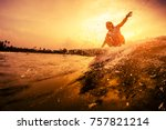 young surfer rides the wave... | Shutterstock . vector #757821214