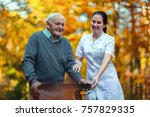 nurse helping elderly senior... | Shutterstock . vector #757829335