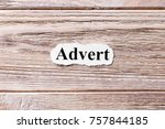 Small photo of Advert of the word on paper. concept. Words of Advert on a wooden background.