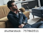 thinking about . handsome young ... | Shutterstock . vector #757863511
