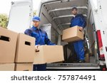 two young male movers carrying... | Shutterstock . vector #757874491