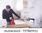 young man spraying fire... | Shutterstock . vector #757885921