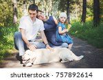 happy family with pet dog at...   Shutterstock . vector #757892614