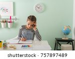 Young Girl Doing Homework At...