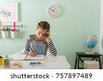 Young Girl Doing Homework At...