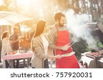 a guy and a girl are cooking... | Shutterstock . vector #757920031