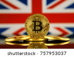 Physical version of Bitcoin (new virtual money) and UK Flag. Conceptual image for investors in cryptocurrency and Blockchain Technology in United Kingdom. - stock photo