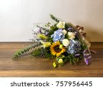bouquet of flowers on wooden... | Shutterstock . vector #757956445
