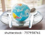 globe model placed on plate... | Shutterstock . vector #757958761