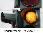 Yellow traffic light close up....