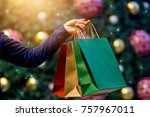 christmas shopping bags in hand ... | Shutterstock . vector #757967011