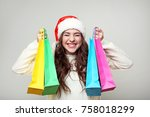 young woman in santa hat with... | Shutterstock . vector #758018299