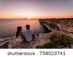 couple overlooks the famous ta... | Shutterstock . vector #758023741