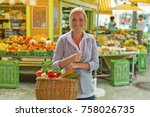 woman at the fruit market with... | Shutterstock . vector #758026735