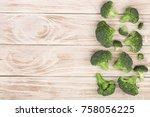fresh broccoli on white wooden... | Shutterstock . vector #758056225