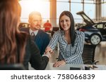 smiling woman customer shaking... | Shutterstock . vector #758066839