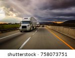 two white 18 wheelers on... | Shutterstock . vector #758073751