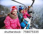 family with children in ski... | Shutterstock . vector #758075335