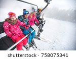 cheerful family in ski lift... | Shutterstock . vector #758075341
