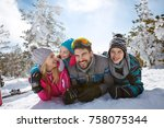 young family together in snowy... | Shutterstock . vector #758075344