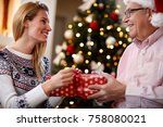 woman having gift surprise from ... | Shutterstock . vector #758080021