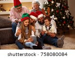 family together in christmas... | Shutterstock . vector #758080084