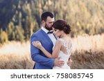 beautiful bride and groom in... | Shutterstock . vector #758085745
