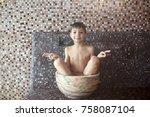 portrait of a boy sitting in... | Shutterstock . vector #758087104