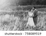 beautiful bride and groom in... | Shutterstock . vector #758089519