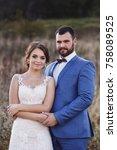 beautiful bride and groom in... | Shutterstock . vector #758089525