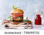 homemade burger in classic bun...   Shutterstock . vector #758090731