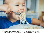 baby in the kitchen eagerly... | Shutterstock . vector #758097571