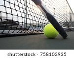 tennis ball and racket on hard... | Shutterstock . vector #758102935