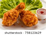 fried chicken drumsticks on... | Shutterstock . vector #758123629