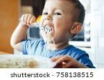 baby in the kitchen eagerly... | Shutterstock . vector #758138515
