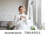 positive cheerful 60 year old... | Shutterstock . vector #758145511