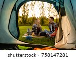 shot of a happy couple camping... | Shutterstock . vector #758147281