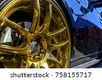 Golden Rims On A Black Car...