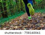 woman running in the autumn park | Shutterstock . vector #758160061