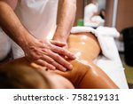 man doing a massage in the spa... | Shutterstock . vector #758219131