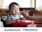 asia baby boy eating food at... | Shutterstock . vector #758239441