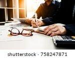 the female secretary holding... | Shutterstock . vector #758247871