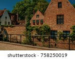 old brick houses and greenery...   Shutterstock . vector #758250019